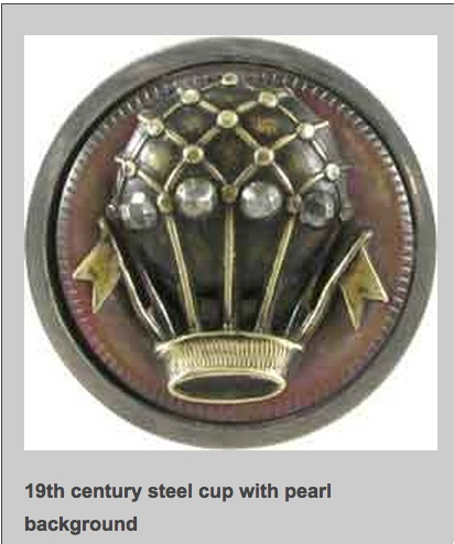 A delightful antique button - steel cup with cut steels and pearl background